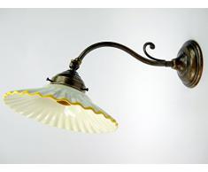 Applique ottone brunito appliques liberty piatto ceramica lampada parete am28.Dimensioni: Altezza15cm,diametro vetro 19cm,sporgenza max 35cm,diametro base10cm.Le dimensioni sono comprensive del piatto.Portalampade attacco Edison E14 (attacco piccolo).