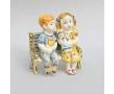 Ceramiche Caltagirone Bimbi su panca in ceramica di Caltagirone